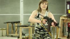Young Girl Aiming AKS-74U - 001 Stock Footage