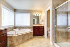 modern bathroom with round tub and shower - stock photo