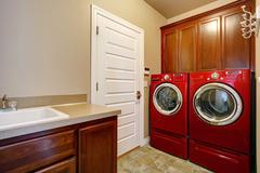 laundry room with modern red appliances - stock photo