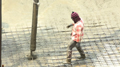 Workers pouring concrete mix on floor from concrete pumping truck. Stock Footage