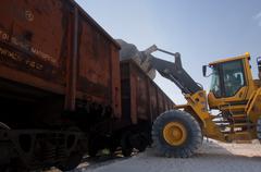 Excavator loads gravel Stock Photos