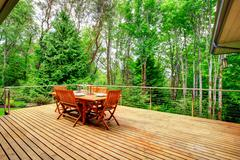 Backyard deck overlooking amazing nature landscape Stock Photos