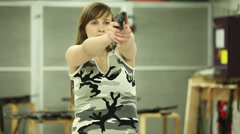 Young Girl Aiming Glock17 - 001 Stock Footage