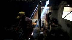 Men preparing food in restaurant kitchen with ambient light streaking through Stock Footage