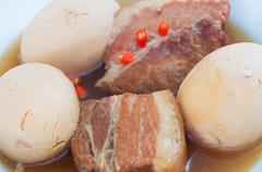thit heo kho trung  vietnamese caramelised pork belly with hard-boiled eggs b - stock photo