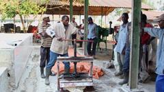 Cassava press wide Stock Footage
