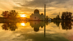 A Floating Mosque During Sunrise With Sunburst Zoom Out Stock Footage