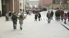 Crowd of people crossing millenium bridge Stock Footage