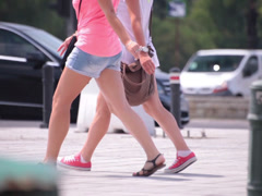 two bluejeans shorts long naked legs young adult women walking - stock footage