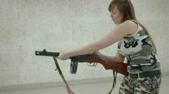 Young Girl Aiming PPSH-41 - Side View - 001 Stock Footage