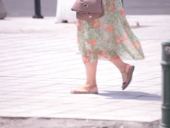 Flowery dress young adult woman walking Stock Footage