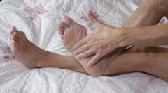 Senior applying foot cream Stock Footage