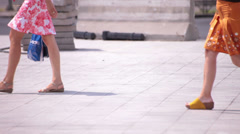 flowery skirt long naked legs young adult women walking - stock footage