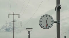 Switzerland clock in rail station - two shots Stock Footage