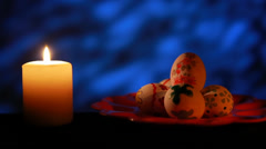 Easter candle with ornaments in the dark Stock Footage