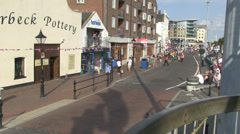 street scene dag and owners walk by summers day in england - stock footage