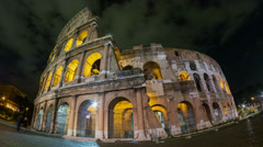 Tourists walking near Rome Colosseum in night time timelapse Stock Footage