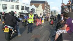 Back of lots of motorbikes passing 2 Stock Footage