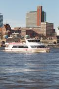 Hamburg Harbor Boat Trip Ferry passes by Landungsbrücken - stock photo