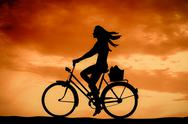 Stock Illustration of retro sunset girl on a bike