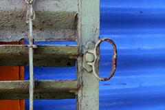 Metal venetian blind and a blue   in la boca buenos aires Stock Photos