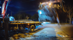4K. Crane lifts crashed car from the highway to the tow truck with a cars Stock Footage