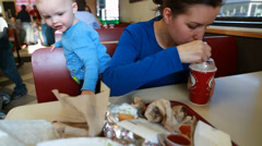 little family eating a milk shake - stock footage