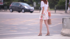 Flowery skirt dress long naked legs young adult woman walking Stock Footage