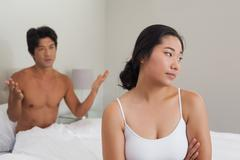 Stock Photo of Couple having an argument in bed