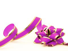 Gold and pink gift bow with ribbon on white Stock Photos