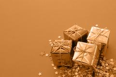 christmas gifts with stars and copy space - stock photo
