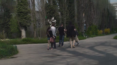 Group Of Young People Visiting An Old Deactivated Power Plant Stock Footage