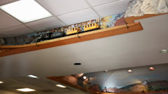 A model train on the ceiling of a restaurant Stock Footage
