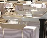 Stock Photo of White chairs and tables, outdoors at a restaurant