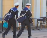 Stock Photo of Couple of Finish navy sailors, walking on sidewalk, in Finland