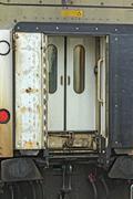 Rear of train passenger car, nobody around - stock photo