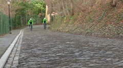Professional cyclists on cobblestones road Stock Footage