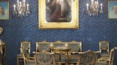 Baroness enters in baroque salon Stock Footage
