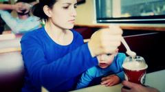 boy and his mother eating a milk shake - stock footage