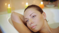 Portrait of a very beautiful girl in a bath Stock Footage