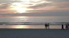 People Walking on Beach during Sunset Stock Footage