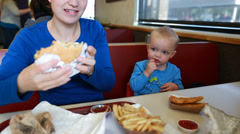 mother and boy eating fast food - stock footage