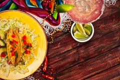 Stock Photo of background: display of tacos and a margarita for cinco de mayo