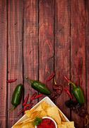 Stock Photo of background: chips and salsa with jalepenos