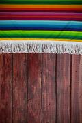 Stock Photo of background: mexican blanket with wooden table copyspace