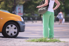 green trousers young adult woman waiting by zebra - stock footage