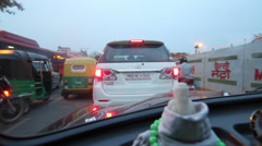 Delhi tail lights and Guru Nanak from taxi - stock footage