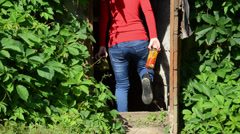 Girl carry preserved food jars with vegetables to cellar storage Stock Footage