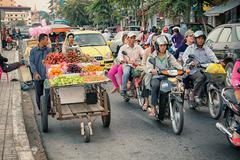 phnom penh, cambodia - 29 dec 2013: heavy traffic through the city streets in - stock illustration