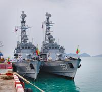 phuket, thailand - 22 feb 2013: two military myanmar ships anchored in phuket - stock illustration